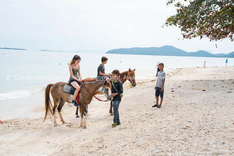 Riding horses along Bang Kao beach Koh Samui