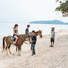 Riding horses along Bang Kao beach Koh Samui