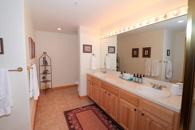 Master bathroom with twin vanity, shower, and Jacuzzi tub.