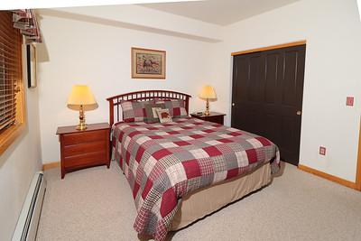 Bedroom 2- Queen bed, flat screen SmartTV, double closet and ensuite full bathroom.