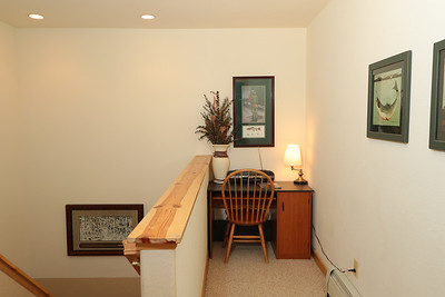 Upstairs work area with desk and condo-wide high speed wifi.