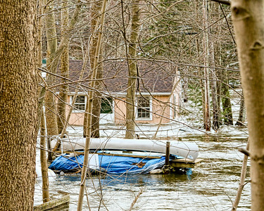 Canoe and Dock...doing alot of good sitting there huh? Flooded Home in Oxford. RTE 34
