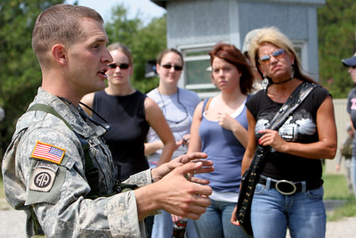 Captain Dave Beskow briefs Naomi Beskow, Janna Kane, Sabrina Pellar and Katherine Haynes on the machine gun range Thursday morning at Wagner Range.
