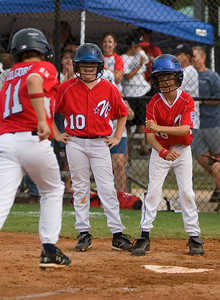 Will Kilgore is greated at homeplate by teamates Jacob Hinson and Dylan Price after hitting a grand slam in the first inning.