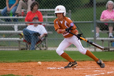 Bull Creek's Timmy Reynolds lays a bunt down the third base line Friday night at Britt David Park.