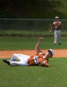 Bull Creek short stop Joseph Gibson hits the ground hard after catching a fly ball against North Columbus Saturday afternoon at Britt David Park.