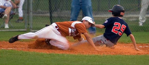 Bull Creek's Joseph Gibson tags North Columbus's Joey Smith out at third base Friday night at Britt David Park.