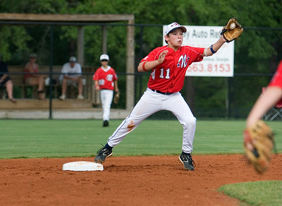 Northern Columbus's second baseman Will Kilgore stretches to catch a throw for an out.