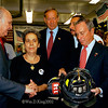 New York City Fire Commissioner Nicholas Scoppetta (left), Governor George Pataki and Mayor Michael Bloomberg (right) meet with victims' families and view the charred remains of firefighting equipment at the Middaugh St. Firehouse, Engine 205/Ladder 118.