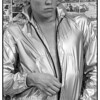 Paul Bridgewater photographed modeling a metallic rain jacket for New York Magazine.