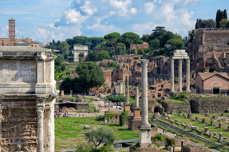 A view of the west Forum from the Capitoline, including ruins of The Temple of Vespasian, Arch of Septimius Severus, The Temple of Saturn, and the  Temple of Vesta