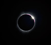 Diamond ring effect at end of maximum totality