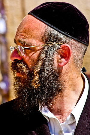 Jerusalem, Israel- This believer where a yamulka and traditional side burns.