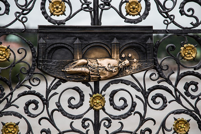 A reclined Bishop on wrought iron on the Charles River Bridge in Prague