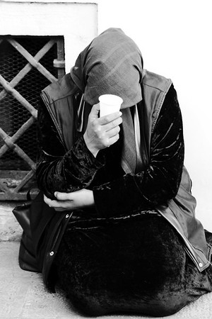 Venice, Italy- A lady asking for alms in Venice.