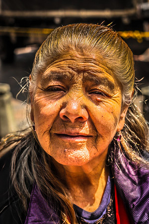 Bogota, Colombia - An elderly lady wears her lifetime struggles on her expression