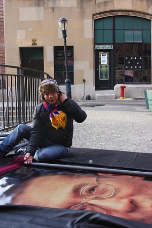 Artist Tendor prepares art installation. Photo Credit: Ben Kostrzewa.