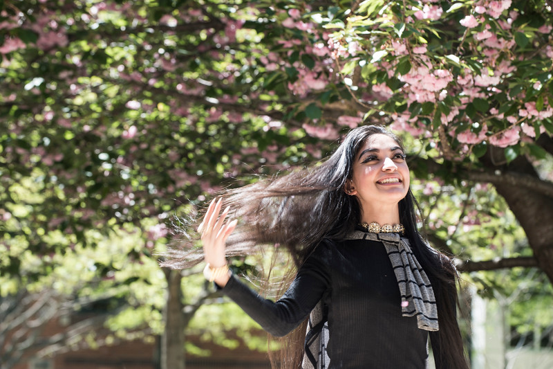 A student enjoys the spring weather. Photo by:  Ron Aira/Creative Services/George Mason University