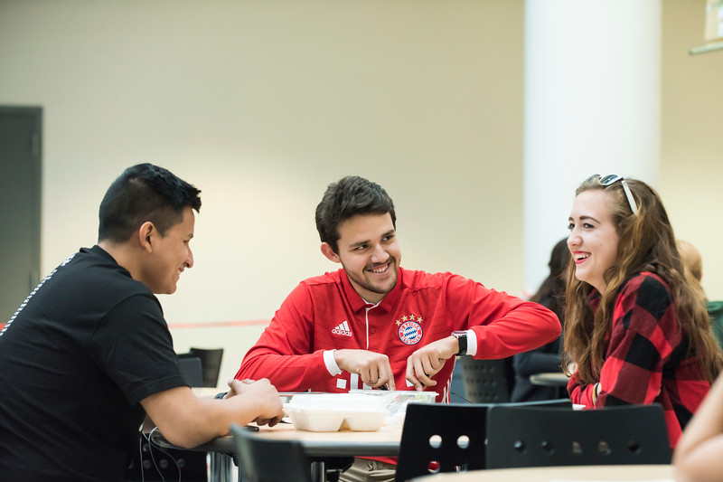 Students eat inside the Johnson Center. Photo by:  Ron Aira/Creative Services/George Mason University