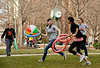 "Mason students play a game they call ""Wackaball"" on the quad near the Clock at Fairfax Campus. Photo by Alexis Glenn/Creative Services/George Mason University"