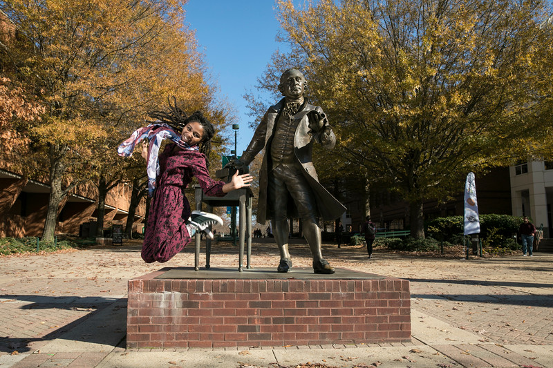 Music Students at the George Mason statue.  Photo by:  Ron Aira/Creative Services/George Mason University