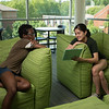 Students hanging out in a study room in Taylor Hall. (Bethany Camp/Creative Services/George Mason University)