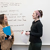 Students collaborate to interpret and analyze quotes in their Intro to Public Health class in Peterson Hall. (Bethany Camp/Creative Services/George Mason University All Rights Reserved)