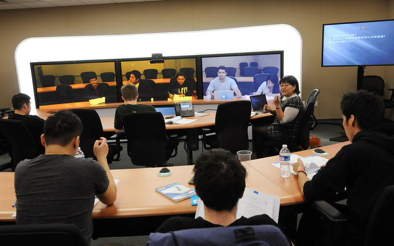 On the Mason Fairfax campus, Instructor Xi Chen teaches students across Virginia, including JMU and UVA students, Chinese for the Business World using TelePresence technology supported by the 4VA initiative. Photo by Evan Cantwell/Creative Services/George Mason University