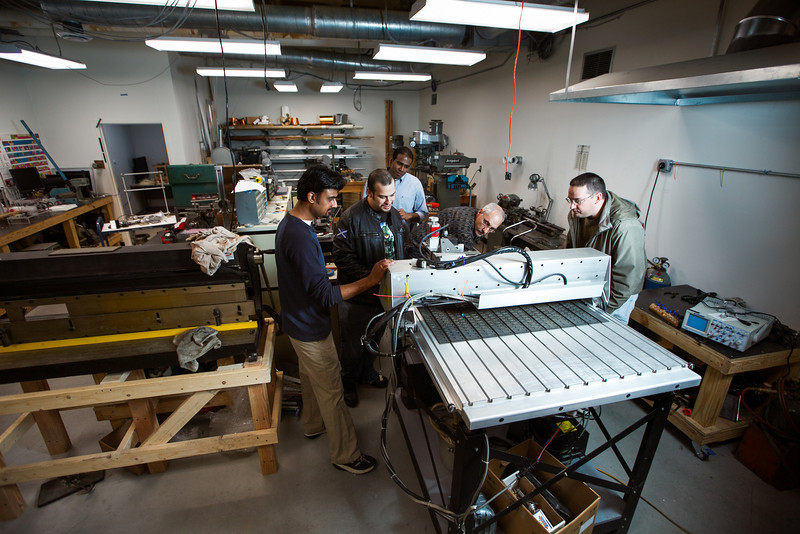 Inventor's Club graduate students modify designs for their FlyPusher invention
