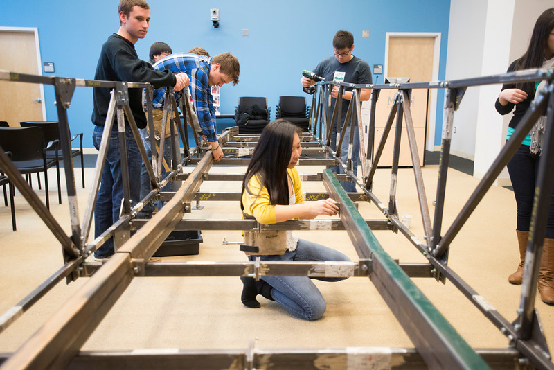 The Mason student chapter of the American Society of Civil Engineers rebuild a steel bridge they designed for competition. The bridge can hold up to 2500 pounds. Photo by Alexis Glenn/Creative Services/George Mason University