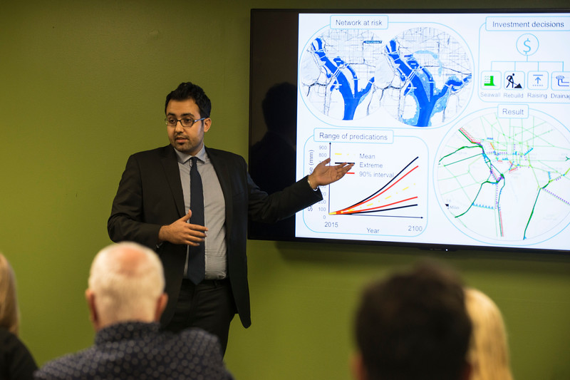 Students give their presentations in front of a panel of judges for the preliminary round of the Three Minute Thesis competition. Photo by: Bethany Camp / Creative Services / George Mason University