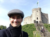 "Pablo Uribe studied this semester at Oxford and won about $2,100 from the Bodleian Library and Blackwells bookshop for an essay explaining ""The Nature of Genius."" He is pictured here in front of Cardiff Castle in Wales. Handout"