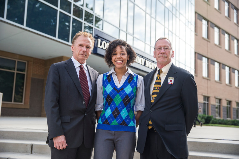 Left to right: Dean of the College of Health and Human Services, Thomas Prohaska, Shannon Turner, and Associate Professor, School of Nursing, Dr. Kevin Mallinson are pictured in an award presentation for student scholarships to Swaziland.  Photo by Craig Bisacre/Creative Services/George Mason University