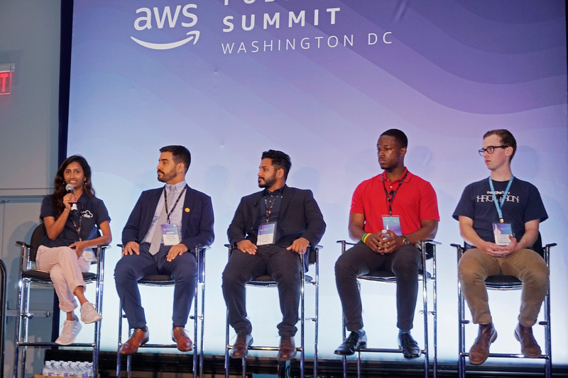 Dolica Gopisetty, left, and Shadman Hossain, third from left,  are George Mason University students representing the AWS Sector Summit in Washington, D.C. Photo by John David Hollis