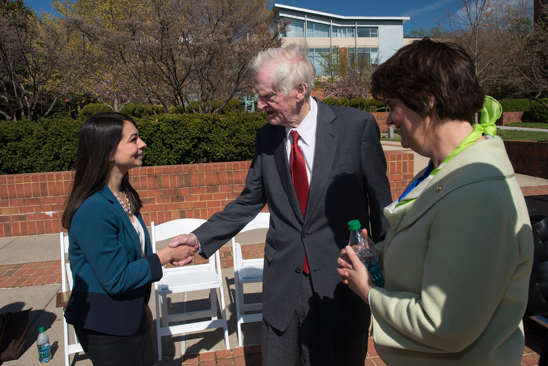 Left to right: Khushboo Bhatia, student body president, former Governor A. Linwood Holton, and Virginia Secretary of Education Anne Holton attend the plaza on the Fairfax Campus dedicated in honor of former Governor. Photo by Evan Cantwell/Creative Services/George Mason University