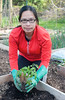 Mildred planting tomato plants.  (Provided by Dean Pike)