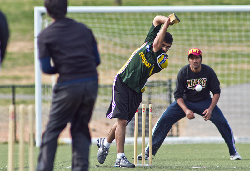 Students take part in an all day cricket tournament on the intramural fields during International Week. Photo by Craig Bisacre /Creatives Services /George Mason University
