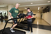 Senior kinesiology major Matt Hetzer monitors Mark Ginsberg, dean of Mason's College of Education and Human Development, during Ginsberg's fitness test at the RAC. Ginsberg volunteered to allow Hetzer to create a fitness program for him as part of a class called Exercise Prescription and Programming.  Photo by:  Ron Aira/Creative Services/George Mason University