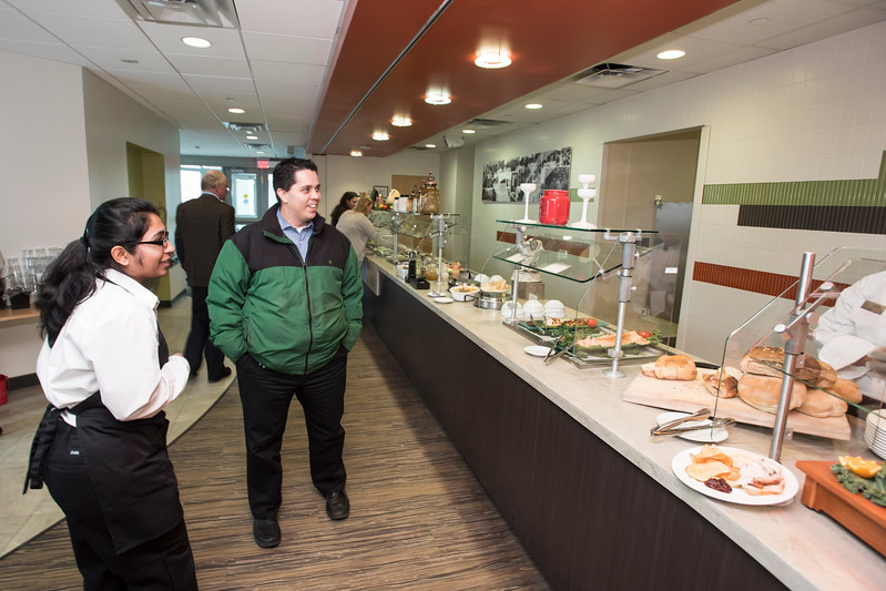 Ken Balbuena, Communications and Marketing Officer, CEHD, hears about lunch options at The Mason Club, a new faculty and staff dining room and lounge opens in Fairfax Campus.  Photo by:  Ron Aira/Creative Services/George Mason University