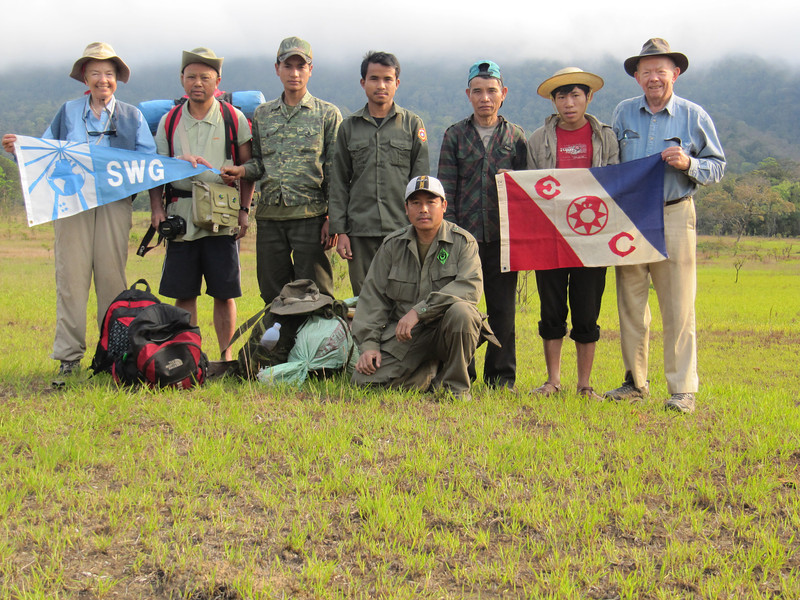 The second is from our 5 week research expedition in the Annamite Mountains of Laos, this past (2011) January and February.  It shows our full group, 2 Lao officials (and good friends), four porters from the nearest village, several days away, Marty and me.  We were in a previously unexplored area investigating a grassland the Lao had told us about, and researching its ecological role and biodiversity significance.  We're holding the international Society of Woman Geographers (of which Marty was President) and the Explorers Club. Such flags are awarded to expeditions that are considered especially significant and noteworthy.