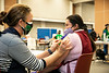 COVID-19 Pfizer-BioNTech vaccine distribution at the HUB Ballroom on the George Mason University Fairfax Campus with support from George Mason University School of Nursing.  Photo by:  Ron Aira/Creative Services/George Mason University