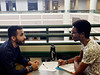 Omar Alkhonini, linguistics grad student and native speaker, converses with Nicolas Philibert, who is taking Arabic 210, during a  session of the Arabic Exchange Program that connects native Arabic speakers with Arabic learners.  Handout photo.