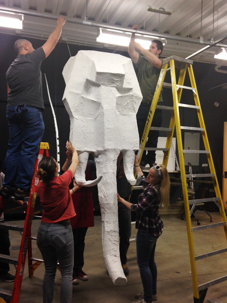The Sculpture I class moving the elephant to be displayed inside the School of Art class room.  Handout