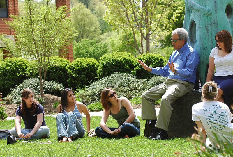 Robinson professor Roger Wilkins teaches a class outside on April 20, 2006.  Photo by Evan Cantwell/Creative Services/George Mason University
