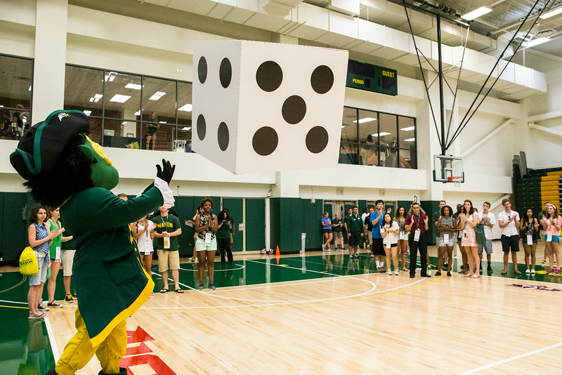 The Patriot rolls an oversized dice in a ticket giveaway sponsored by Athletics during the orientation event Rockin' the Rac. Photo by Craig Bisacre/Creative Services/George Mason University