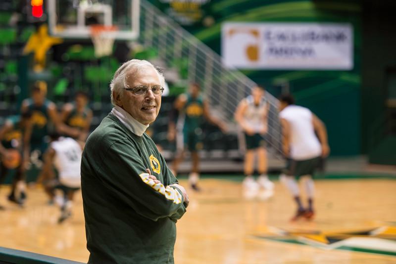 Dr. Louis C. Buffardi participates in the men's basketball sideline coaching program.  Photo by Ron Aira/Creative Services/George Mason University