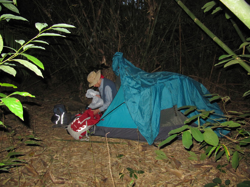 This one is Marty packing our backpacks before dawn at a camp in a bamboo forest.  Everything goes in plastic sacks to keep out water and bugs.