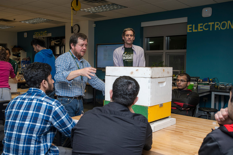 The Honey Bee Initiative (HBI) director German Perilla gives a presentation at the Beehive Hackathon. Students discuss the problem, brainstorm, design, build, and experiment with different solutions. <br />  Photo by: Bethany Camp / Creative Services / George Mason University