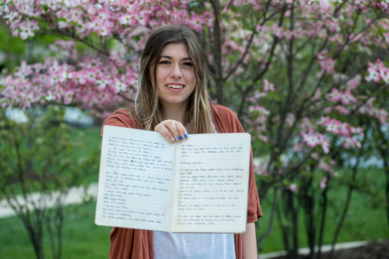 Carmine Gothard, a freshman at George Mason, showcases her poetry.  Bethany Camp/Creative Services/George Mason University