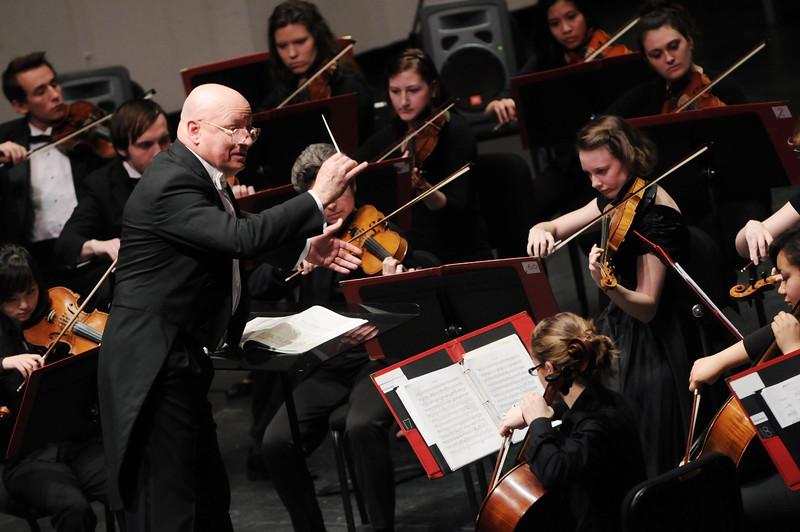 Dennis M. Layendecker conducting George Mason University  Symphony Orchestra.  Photo by Evan Cantwell/George Mason University